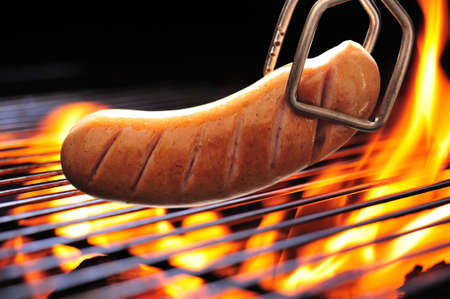 grilled sausage on the flaming grill photo