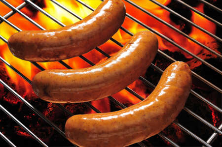 grilled sausages on the flaming grill photo