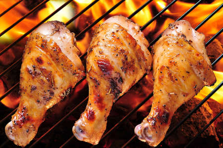 Grilled chicken legs on the grill.