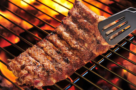 rib: grilled pork ribs on the grill. Stock Photo
