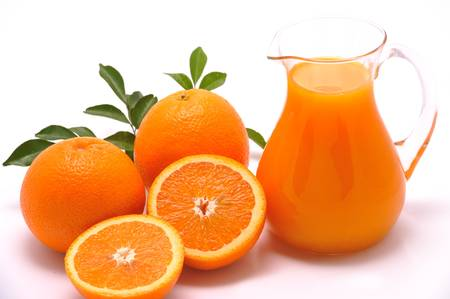 Orange and orange juice isolated on white photo
