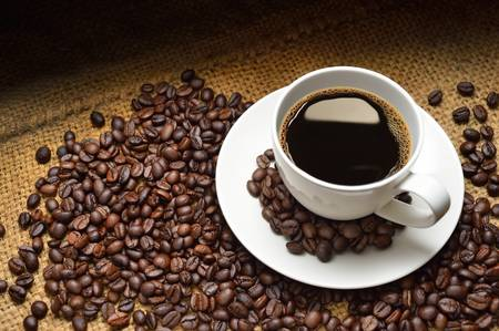coffee cup nd coffee beans photo