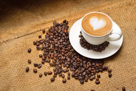 coffee crop: Latte art and coffee beans Stock Photo