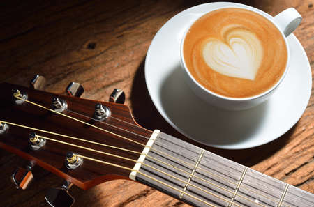 latte art: Latte art and guitar on wooden table