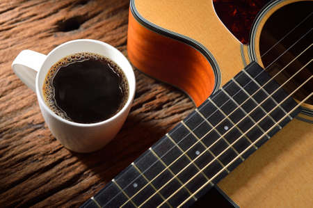 barista: coffee cup and guitar on wooden table