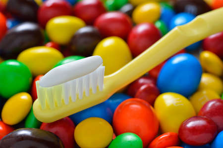 toothbrush on candy background photo