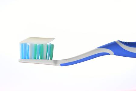 Toothbrush with tooth paste on white backgrou photo