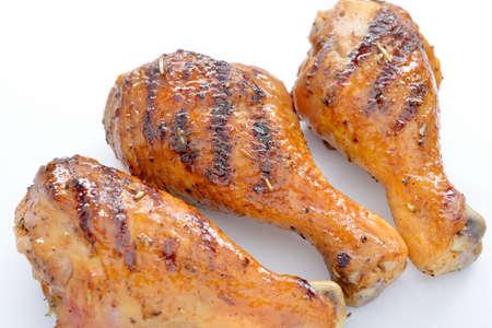 chicken leg: Grilled chicken leg on white background.