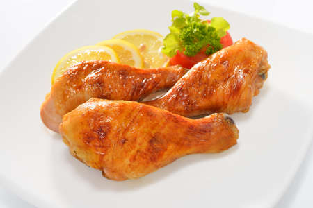 Grilled chicken legs with vegetables photo