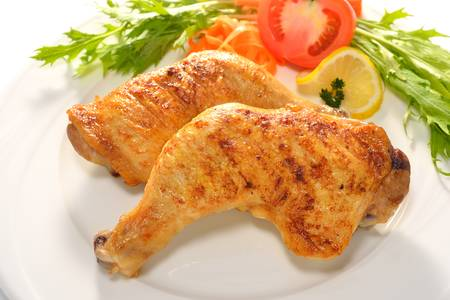 chicken grill: Grilled chicken thigh with vegetables on white plat Stock Photo