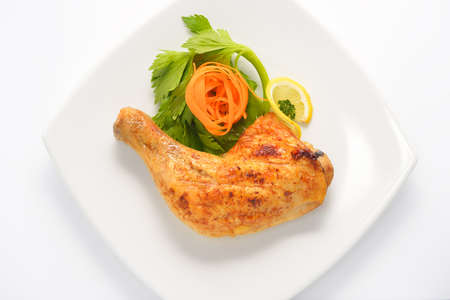 thigh: Grilled chicken thigh with vegetables on white plat Stock Photo