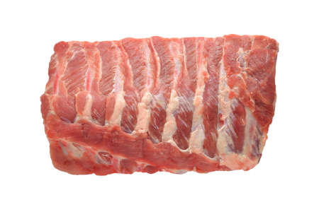 rib: Costillas de cerdo sin procesar en el fondo blanco