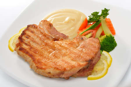 Pork steak with vegetables and mashed potatoes photo