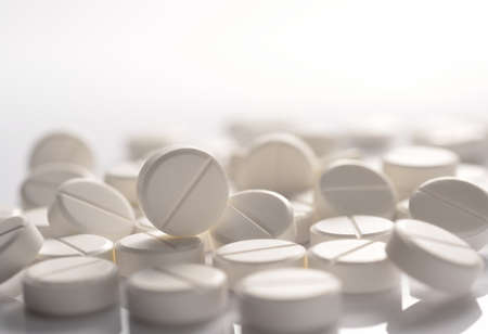 white round medicine tablets on white