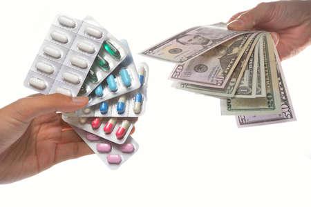packs of pills: Pills and money on white Stock Photo
