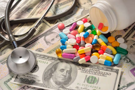 medical bill: Pills and money Stock Photo