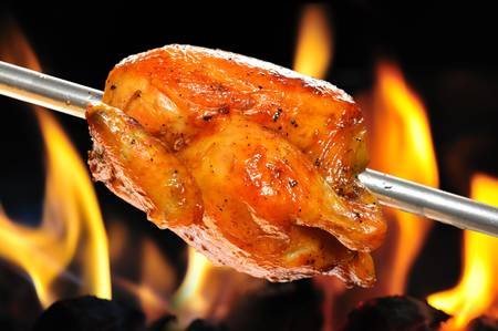 chicken grill: roasted chicken on flame background Stock Photo