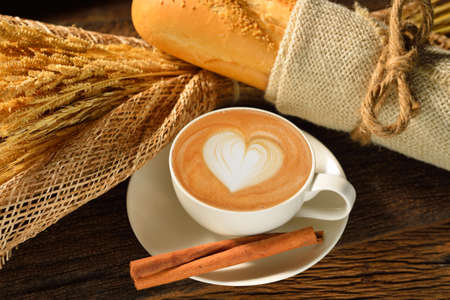A cup of cafe latte and bread  photo