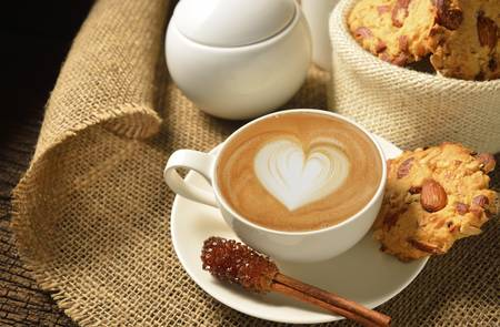 A cup of cafe latte and cookies