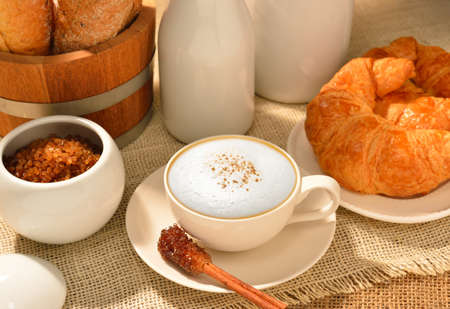 A cup of cappuccino with bread and croissant Stock Photo - 21013433