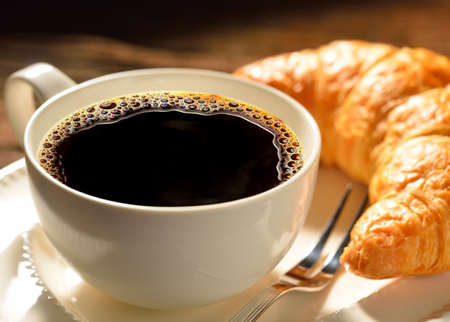 croissant: Coffee cup and croissant