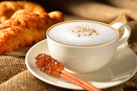 A cup of cappuccino with bread and croissant Stock Photo - 21131365