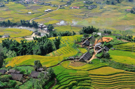 rice paddy: Rice terraces and village in Sapa, Vietnam Stock Photo