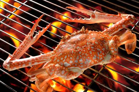 Grilled crab on flaming grill photo
