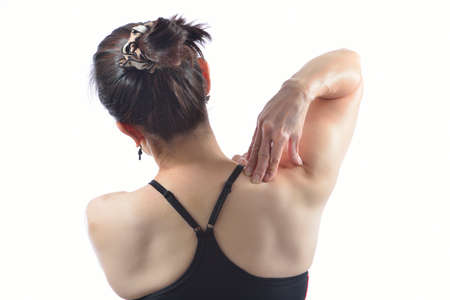 Woman pressing her hand against a painful shoulder  photo