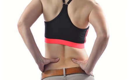 mujeres de espalda: Mujer con dolor de espalda en el fondo blanco Foto de archivo