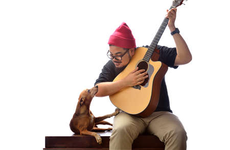 man dog: Man with his dog and guitar On white background