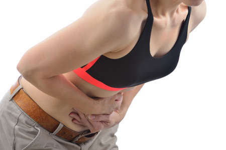 Woman with pain in stomach photo