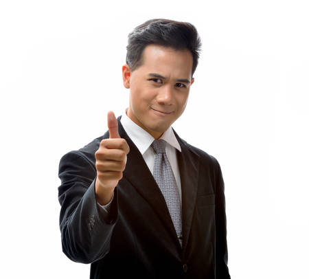 Smiling young businessman with thumb up photo