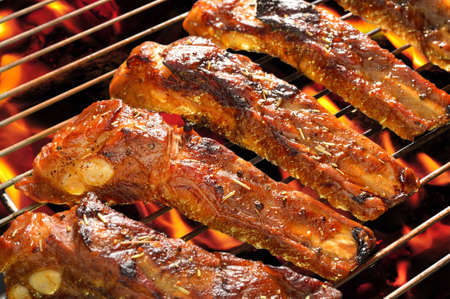 Grilled pork spare ribs on the grill