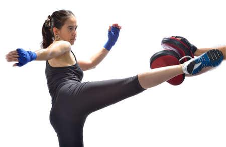 Woman practicing thai boxing technique   Muay Thai
