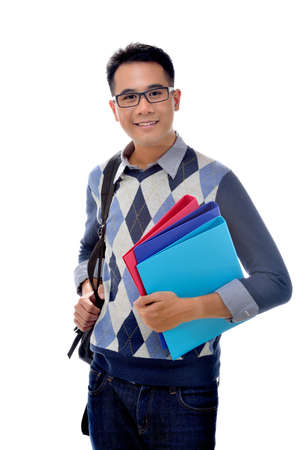 Young happy student carrying books photo