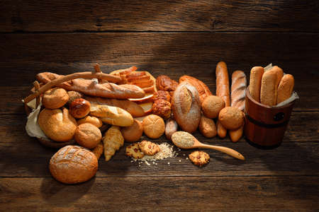 Variety of bread on old wooden   photo