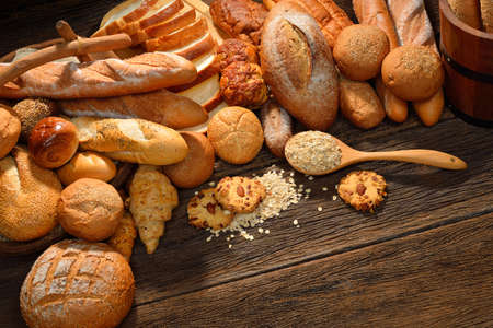 Variety of bread on old wooden
