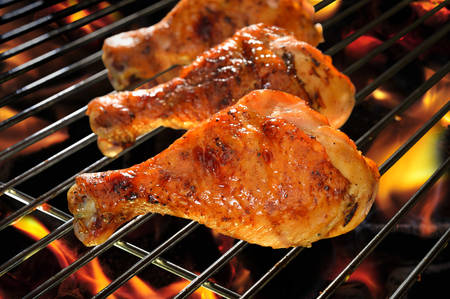 bbq chicken: Grilled chicken Leg on the flaming grill
