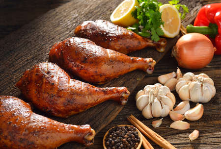 chicken leg: Roasted chicken with ingredients on wooden table  Stock Photo
