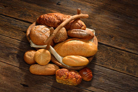 Variety of bread on old wooden background  photo