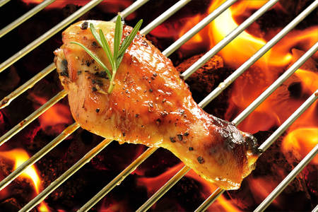 chicken grill: Grilled chicken leg on the flaming grill