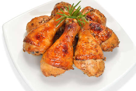 chicken leg: Grilled chicken legs with rosemary on white plate