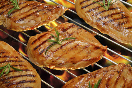 chicken breast: Grilled chicken breast on the flaming grill  Stock Photo