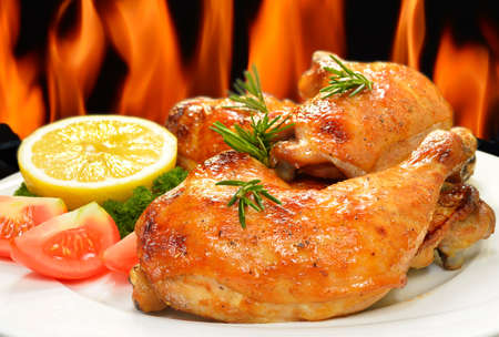 Grilled chicken thigh with vegetables on white plate  Stock Photo