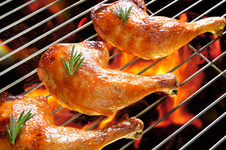 chicken grill: Grilled chicken thigh on the flaming grill  Stock Photo