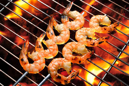 Grilled shrimps on the flaming grill photo