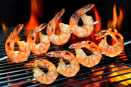 charcoal grill: Grilled shrimps on the flaming grill Stock Photo