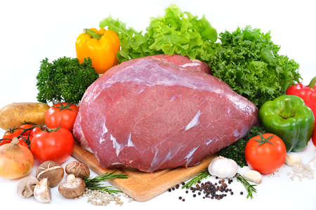 Raw meat ready to be cooked isolated on white ,beef   photo