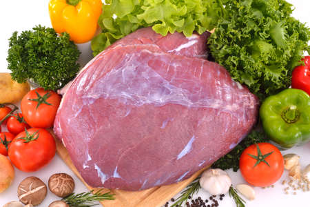 Raw meat ready to be cooked isolated on white , beef   photo